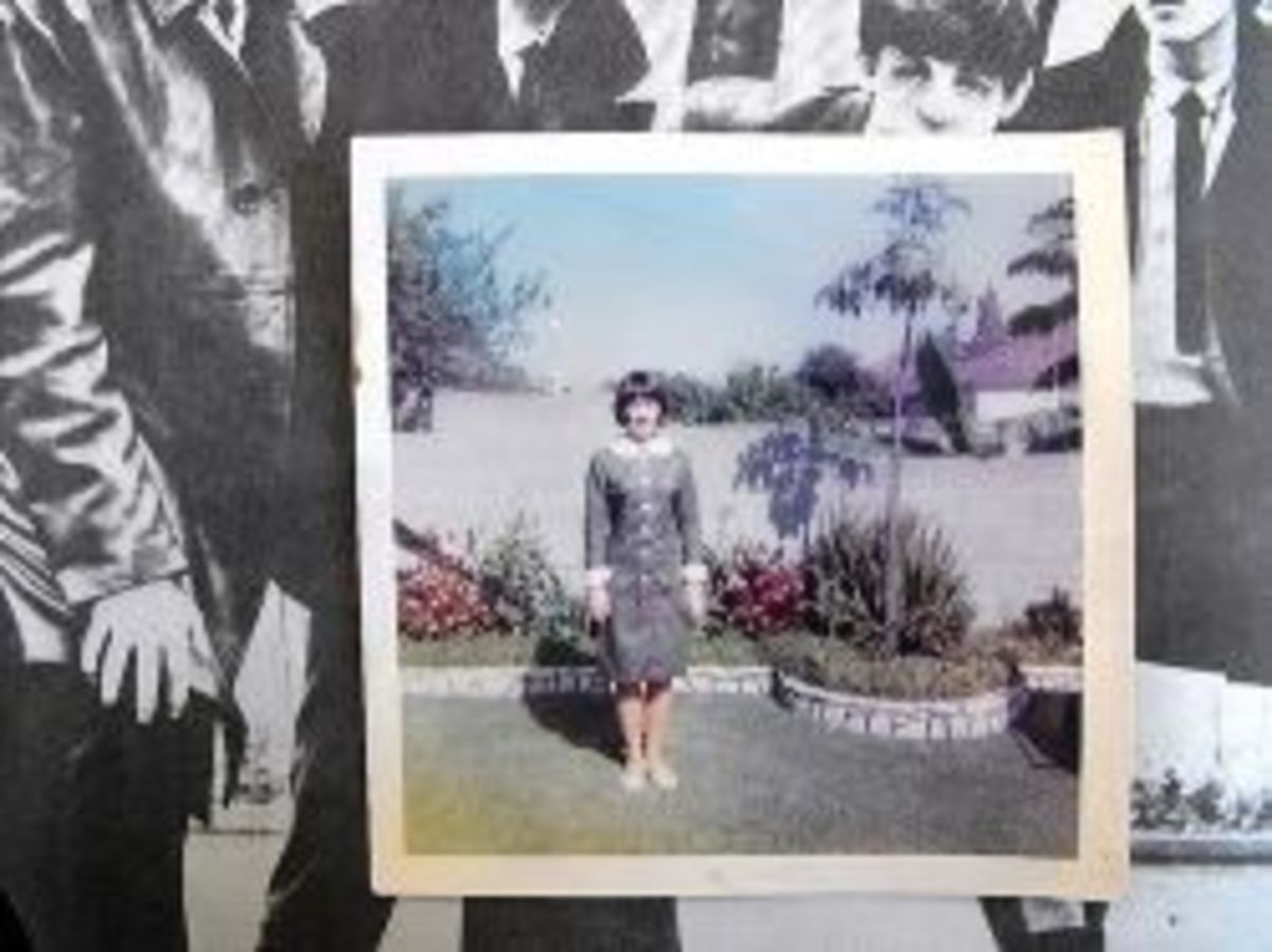 The dress I made for the concert. Inspiration was the Beatles gray suits in a Hard Days Night. I also was one of the first in high school to go with the mod hair style. The high backcomb was pretty much still in.