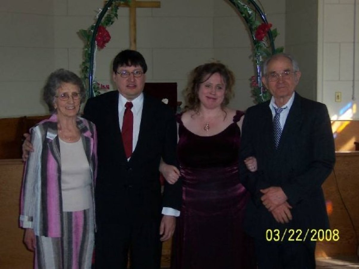 This is a photo of my Grandma, on the left hand side, with my husband, me, and my Grandpa. (at our wedding)