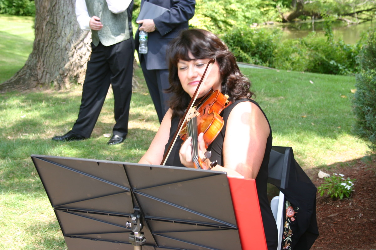 Christine playing her violin at our wedding in 8/2010