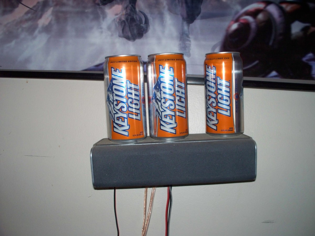 A speaker is used to display a collection of beer.