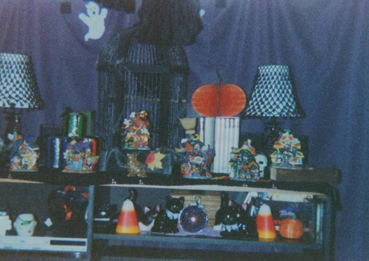 Store-bought and hand-crafted Halloween décor covering the entertainment center.