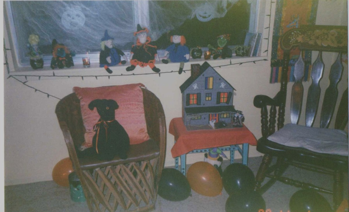 The house that burned. A collection of my Mother's crocheted witches and one of our plastic canvas haunted houses.