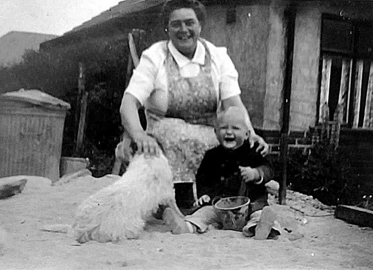Grandma with my older brother when he was about a year old and their much-loved dog, Peggy.