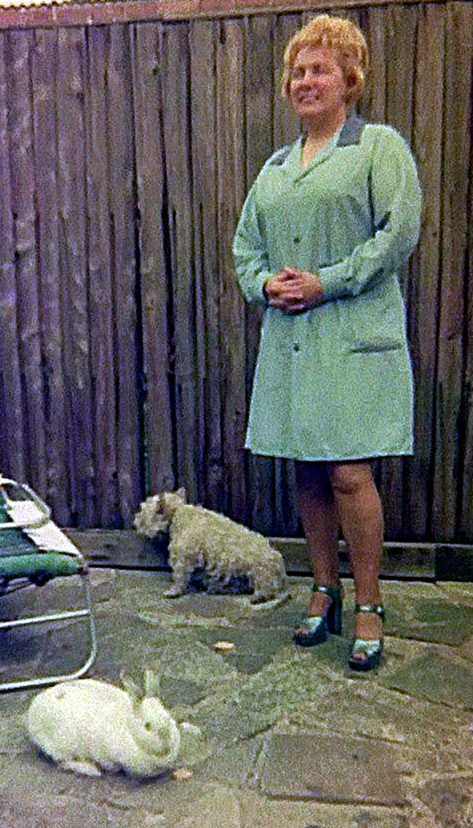 My mum in our back garden in the 1970s, with Mitzie the dog and Snowball the rabbit.