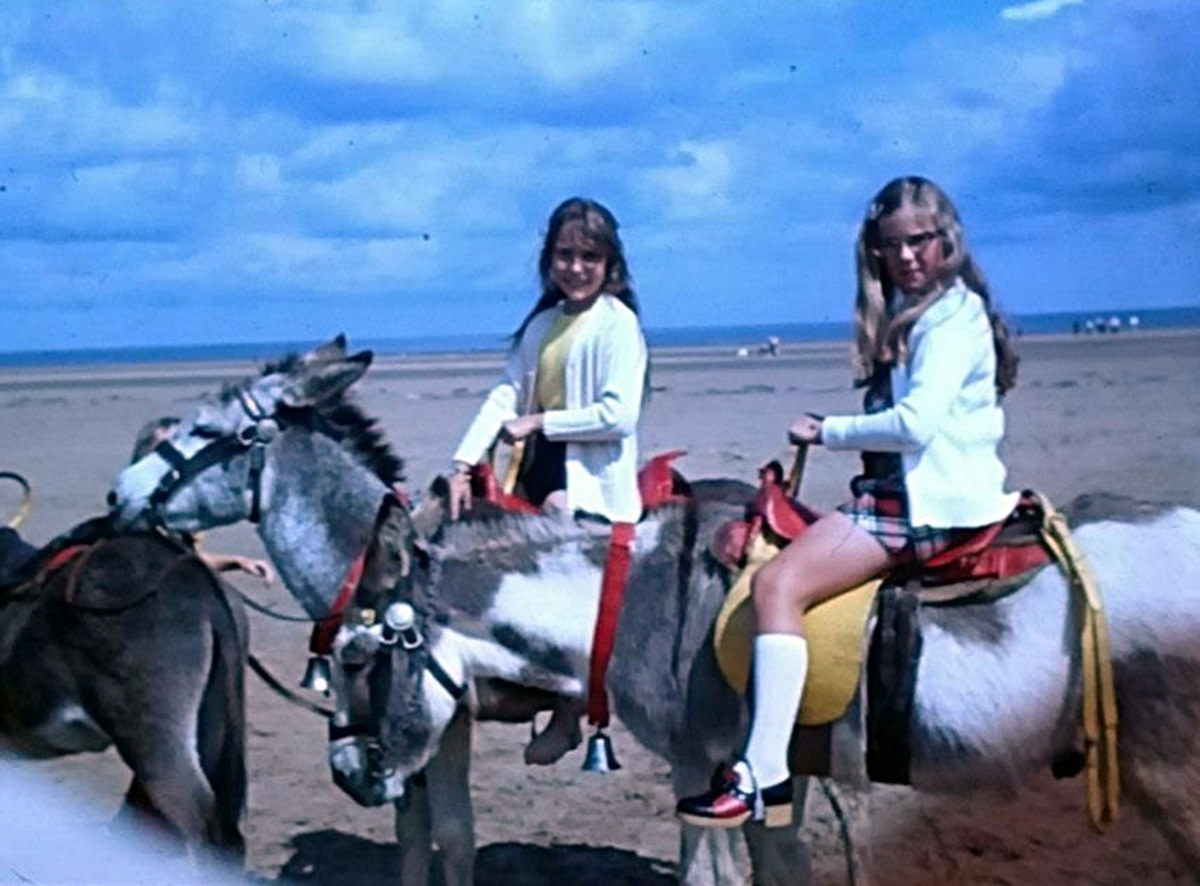I am pictured, on the left, with my cousin Sharon, enjoying a donkey ride on the beach near where I lived. I started longing for a pony of my own at this time.