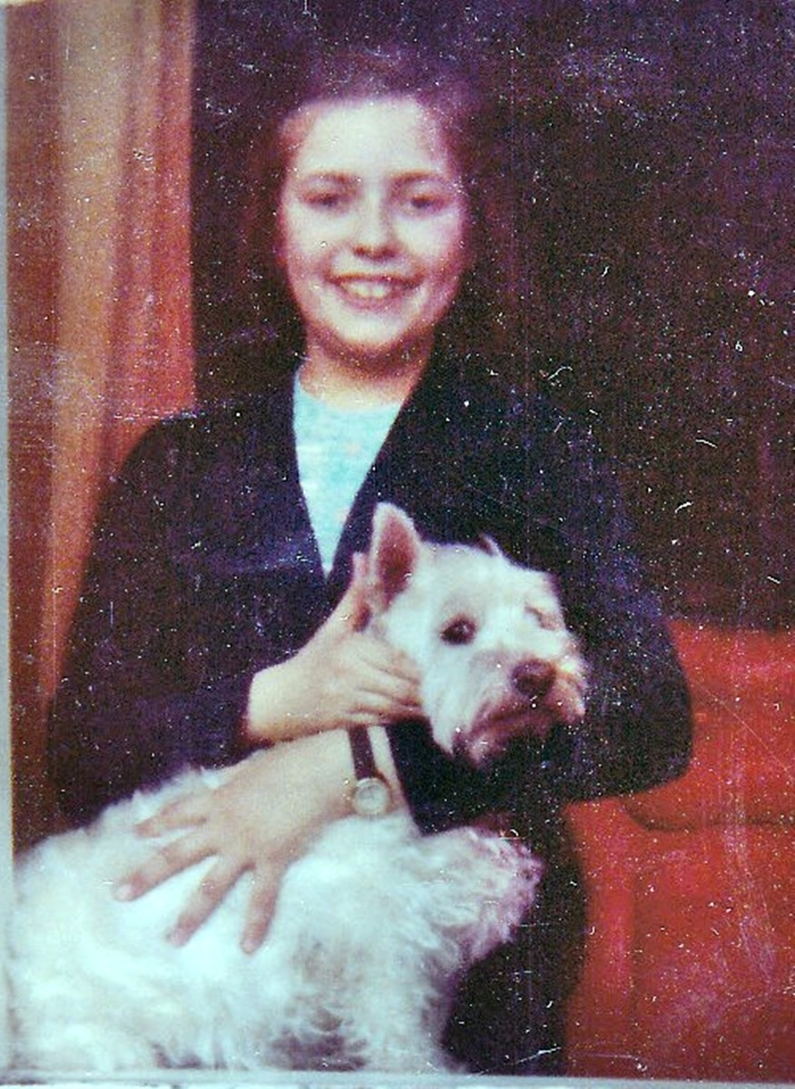 Posing with my dog, Mitzie, in the 1970s, my favourite red chair in the background.