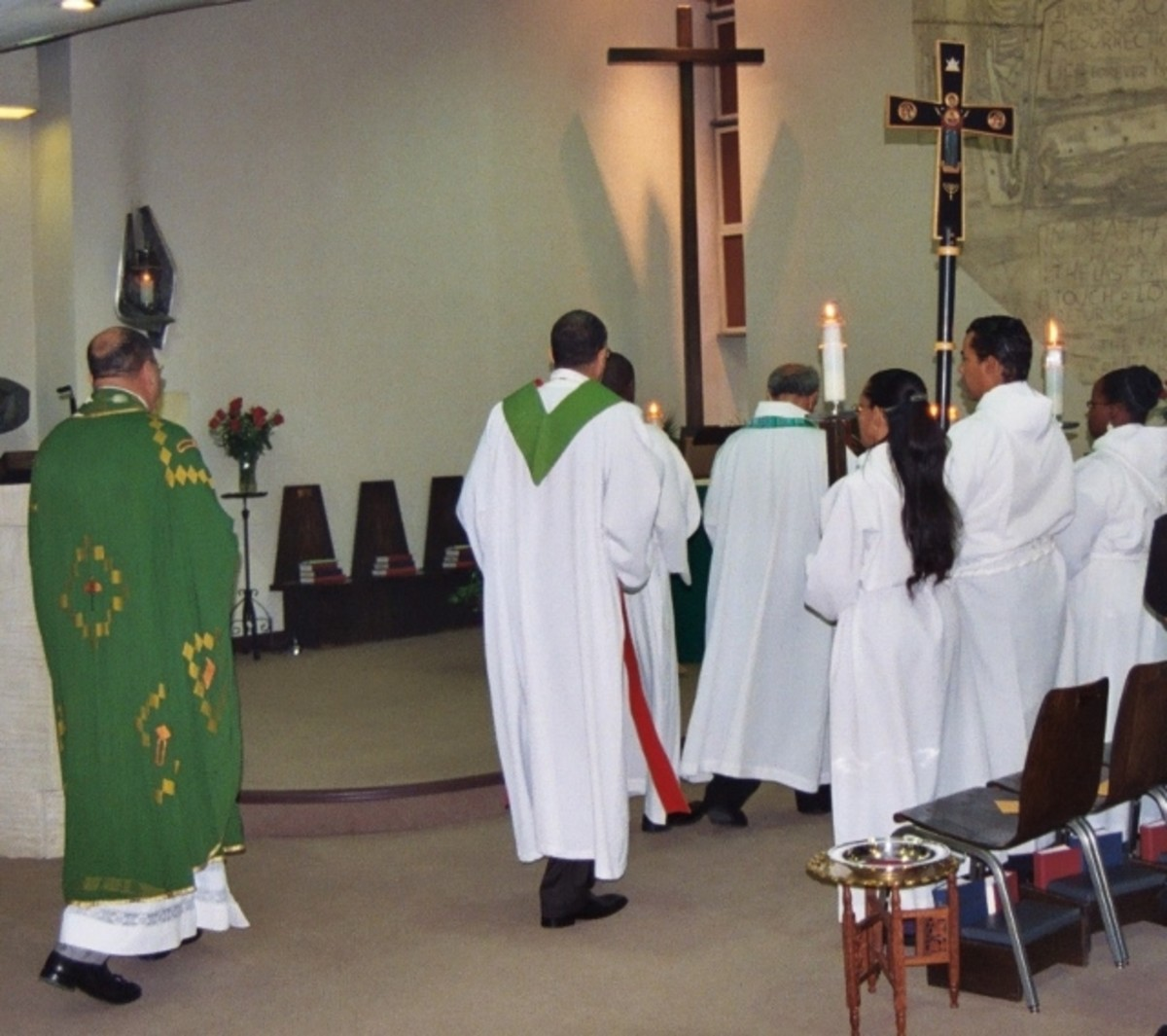 Celebrants and acolytes approach the altar to begin a special service at Saint George's in Washington, DC.