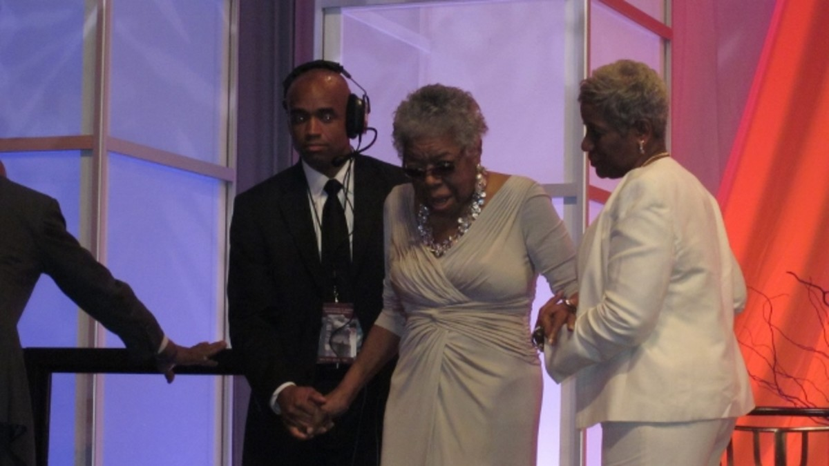 Dr. Angelou is escorted on stage to recite her poem at the Washington Convention Center on August 26, 2011 in Washington, DC.