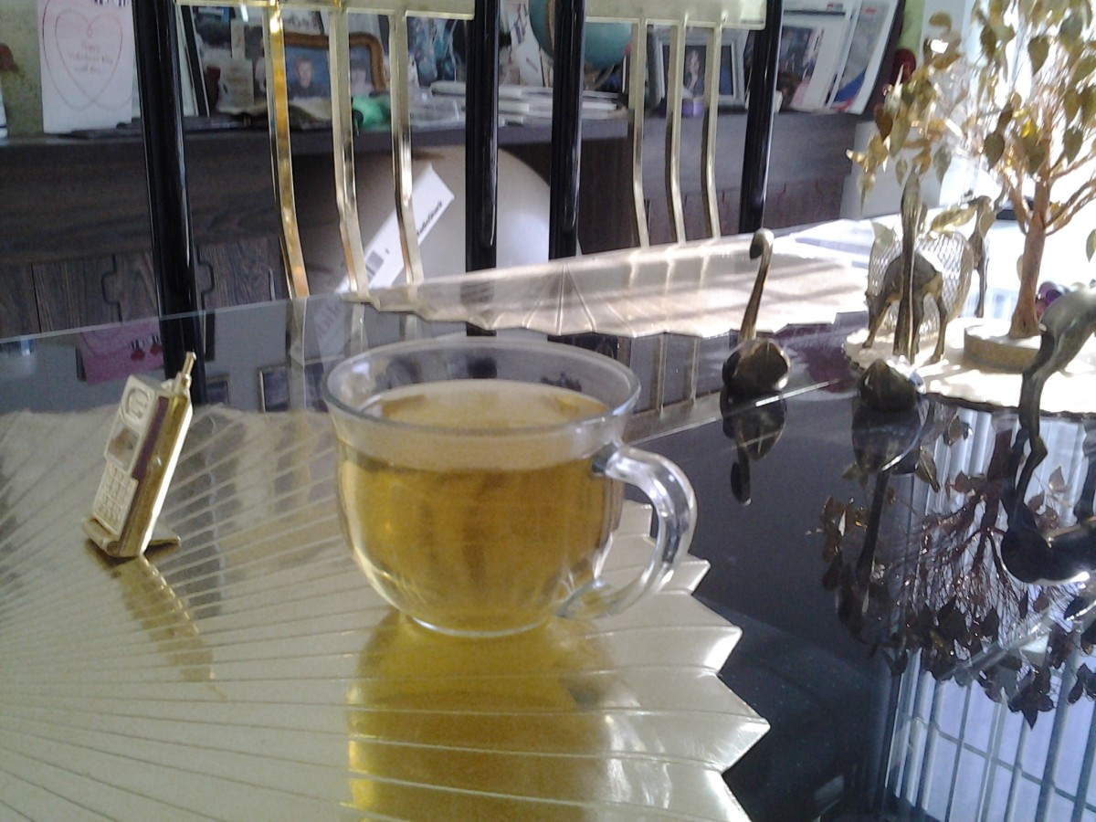 A cup of Sage tea I had a couple of nights ago. 1 Tbs. of rubbed sage leaves steeped in a cup of hot water.