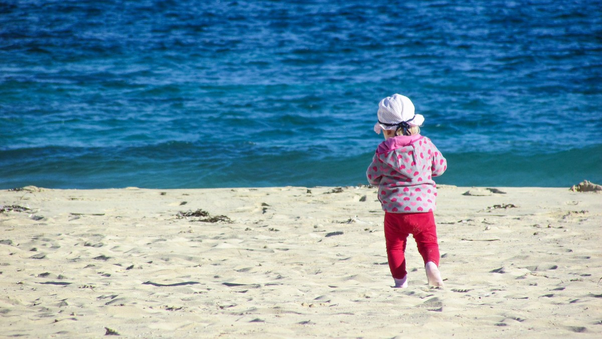When I walked alone as a child on hot sand.