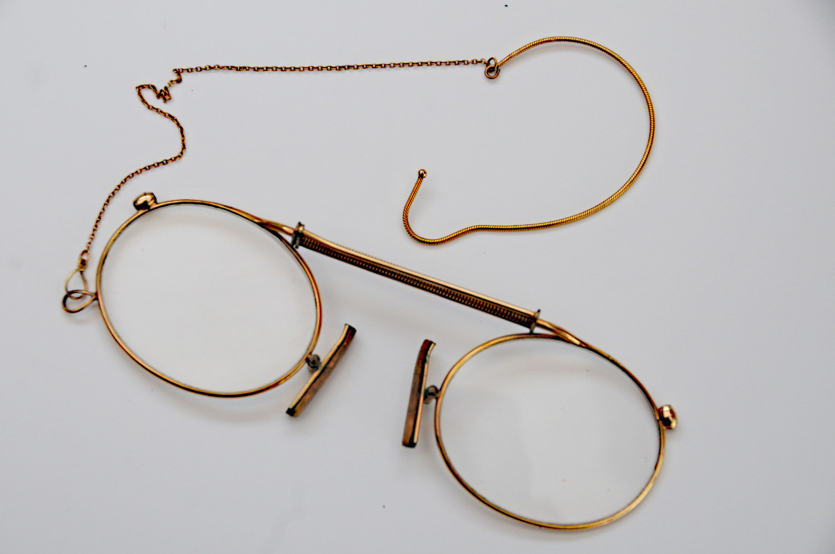 A vintage pair of spectacles  Not pink but gold glasses!