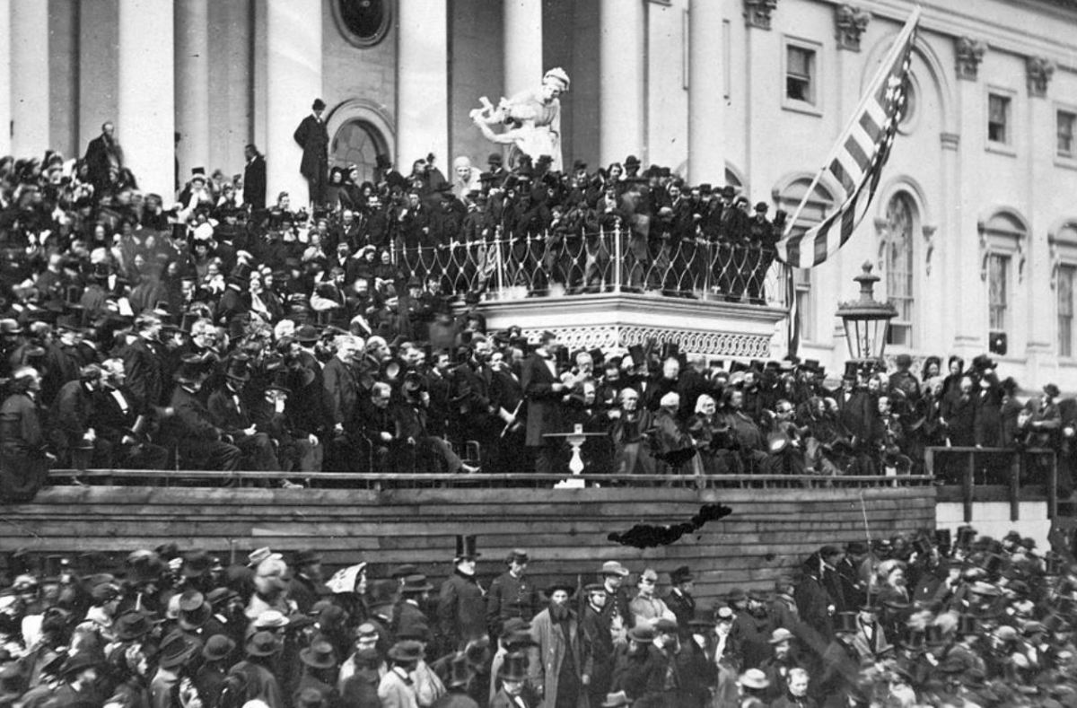 Abraham Lincoln's second inaugural. John Wilkes Booth is thought to be the hatless man on the balcony above Lincoln (center) and to his left.