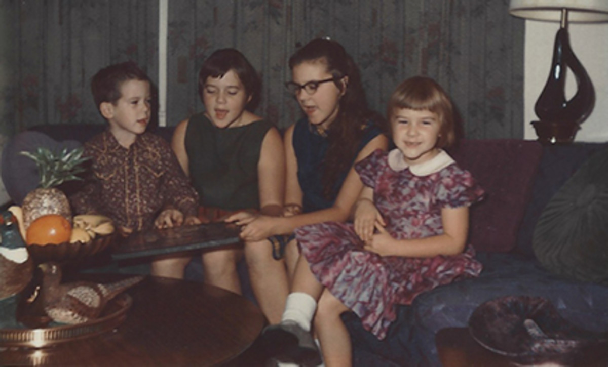 My sisters, brother, and I singing.  I'm wearing glasses at 13.
