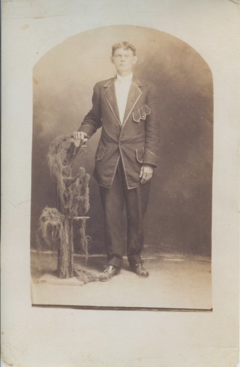 Grandfather in his dandy new suit he bought for his graduation from barber college.