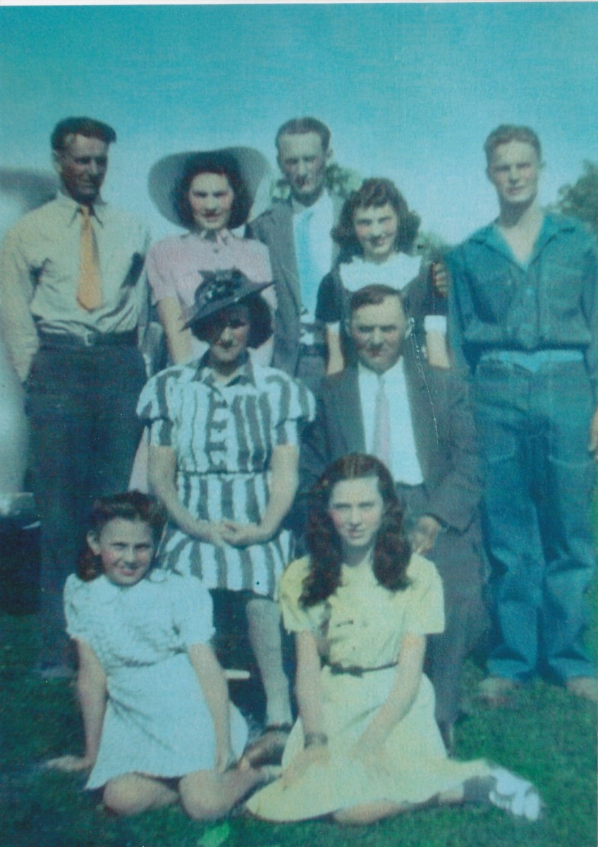 From left to right standing:  dad, aunt Marie, uncle Augie, aunt Laura, and uncle Dick.  Grandma and grandpa are sitting.  From left to right in front:  aunt Florence and aunt Helen