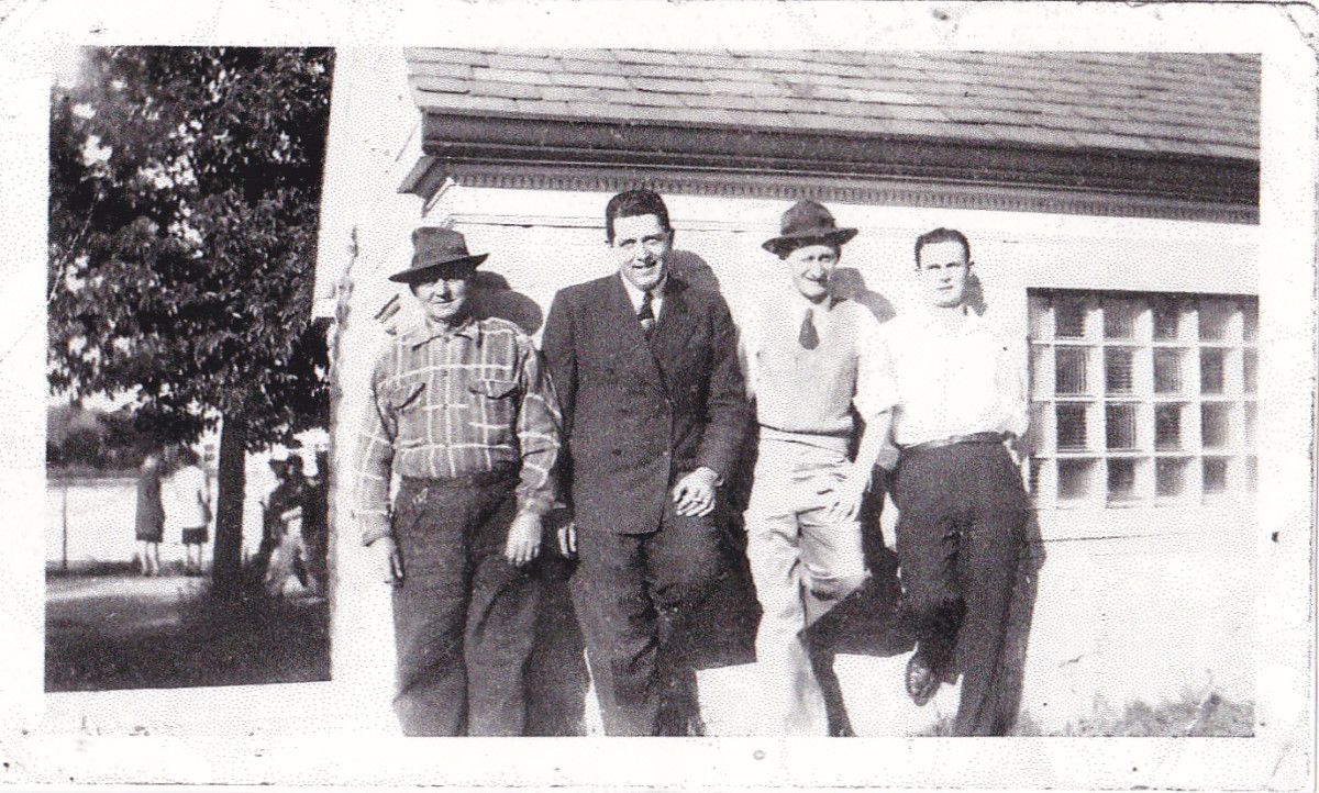 From left to right:  grandpa Kuehn, aunt Marie's husband, Chuck Hyland, uncle Augie, and uncle Dick.  Picture taken around 1950.