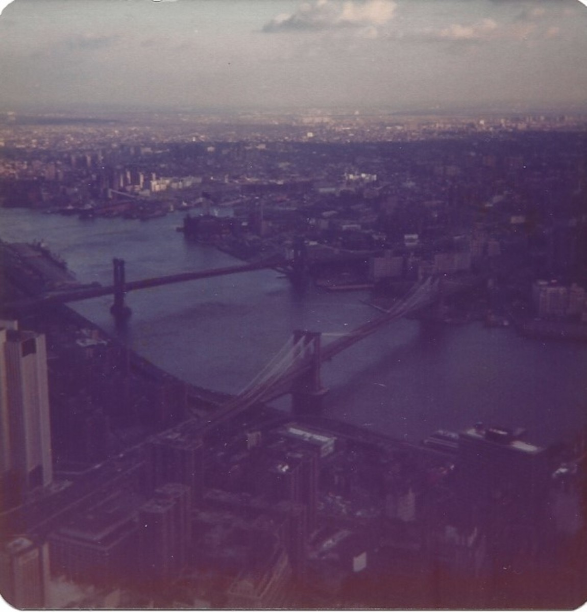 View of the Brooklyn and Manhattan Bridges from the observation deck of the World Trade Center, December 1979.