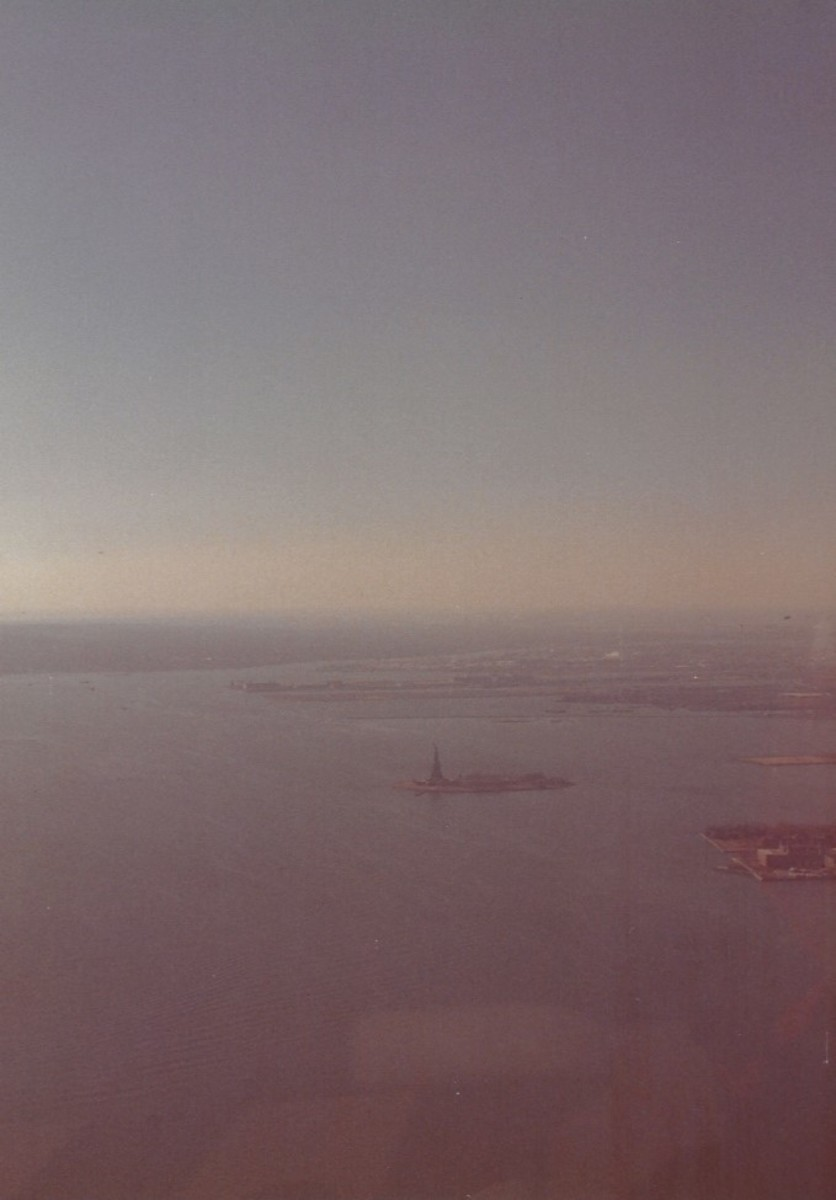 The view of The Statue of Liberty from the observation deck of the World Trade Center, December 1988.