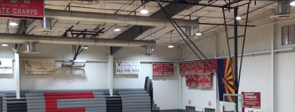 The gym at Auga Fria was full of State Championship banners.  The school won many state championships in basketball and football.