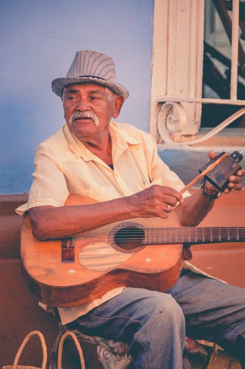 At peace playing his songs.
