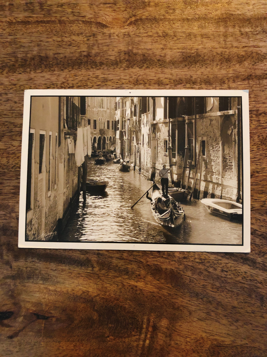10. Venice, Italy. A postcard from Venice. I love the black and white image on this postcard. The gondola through the canal is a significant of Venice!