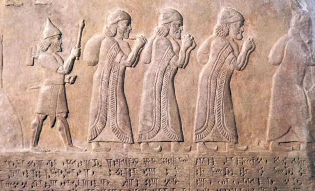 Ancient wall relief of Babylonian warrior leading Hebrews into exile