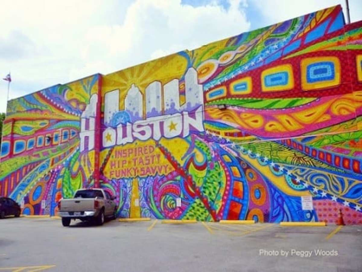 Mural at 420 Travis Street in Houston by Aerosol Warfare