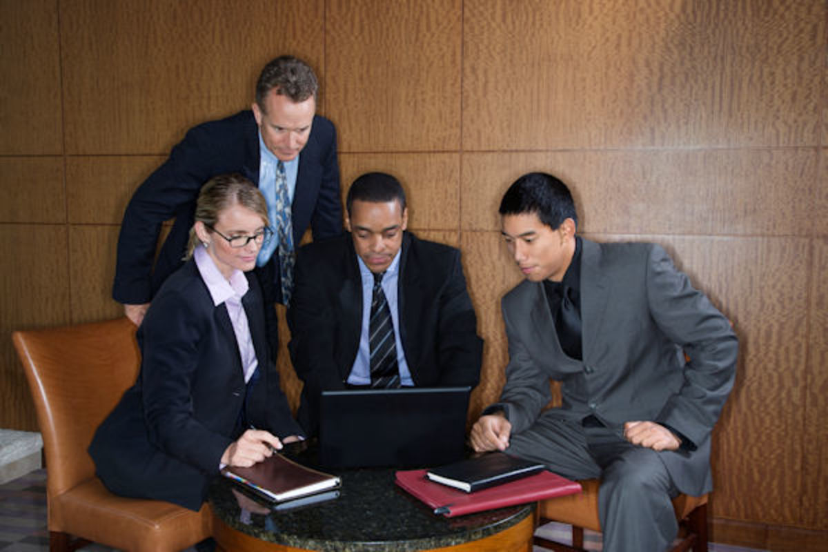 The four conspirators search the Internet hoping to find a company for Ava to invest in.