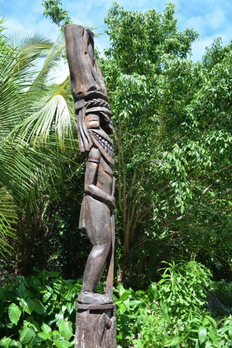 traditional totem poles are dotted through the island