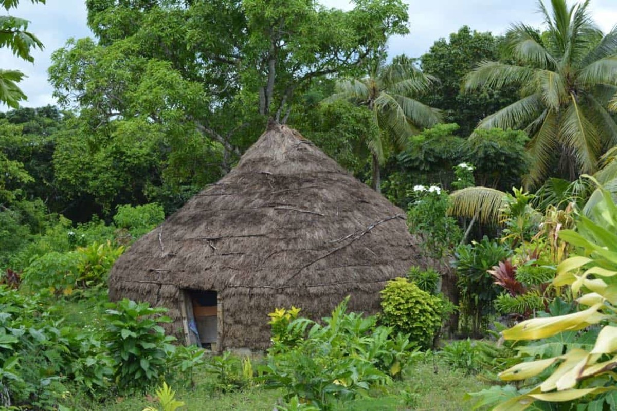 Traditional round grass hut.  most of the native people now live in basic houses, but a number still have kept the original huts on their land as well.