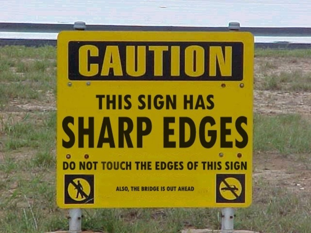 A sign warning us that the sign has sharp edges (oh, yeah, by the way, the bridge ahead is out)