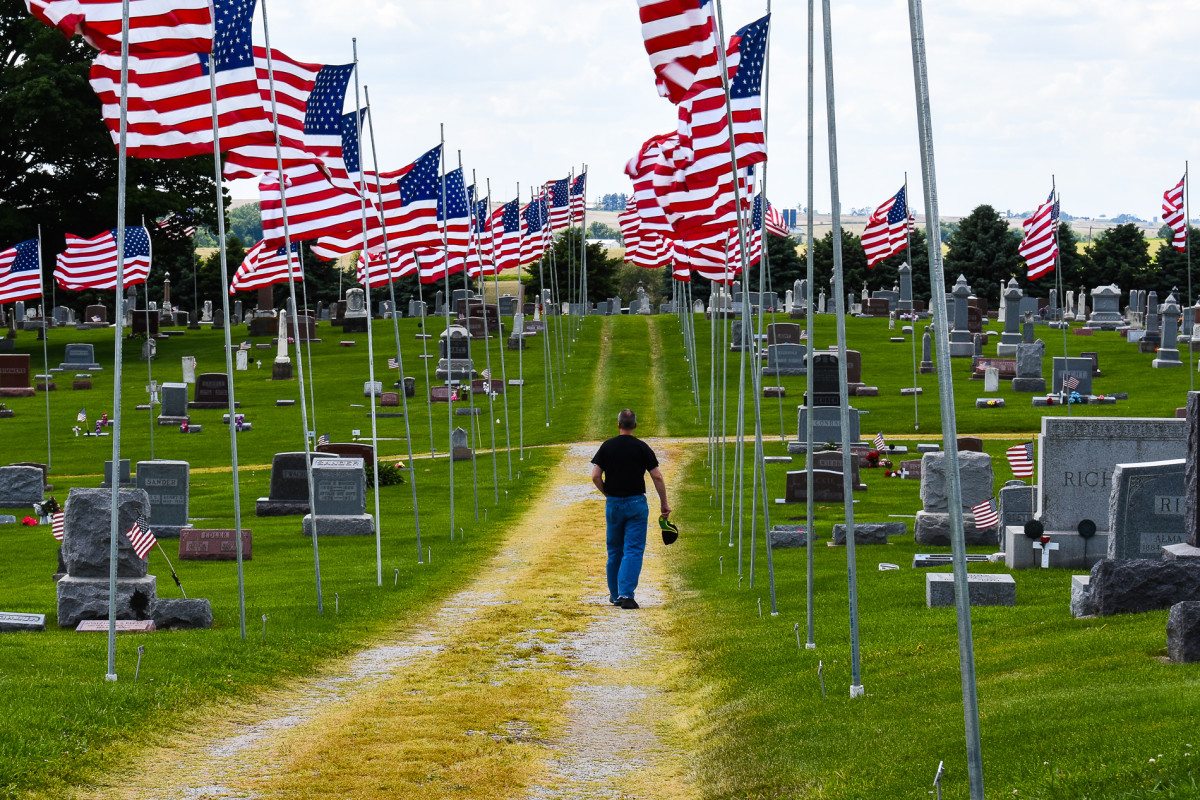 This small-town cemetery in Lowden, Iowa has an incredible display of American flags. It is a must see.
