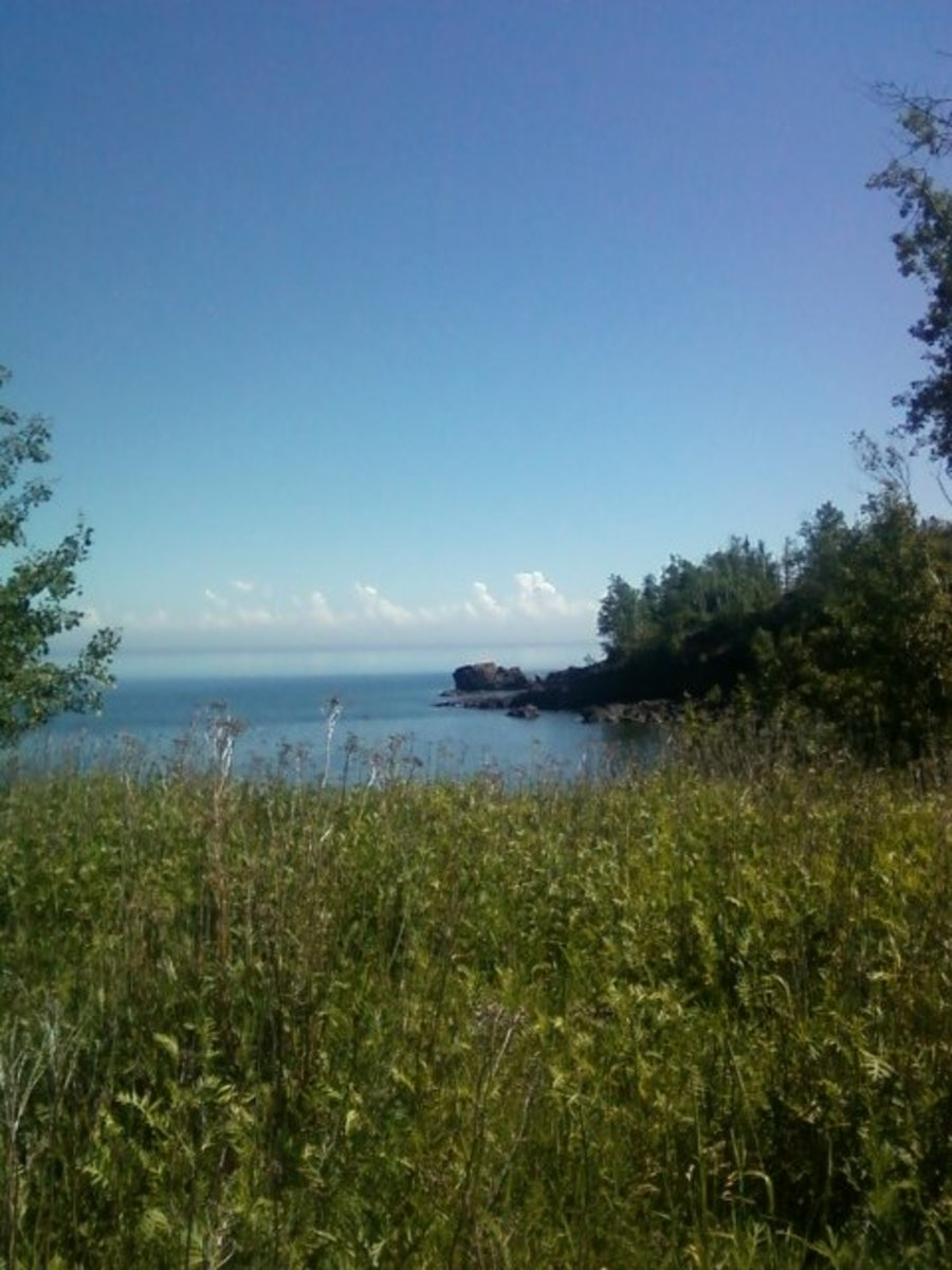 The peaceful beauty of a Lake Superior shoreline on a calm summer day reminds us of gentleness.