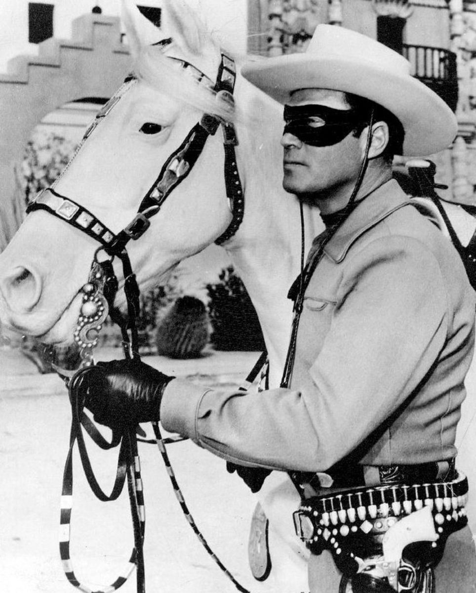 Publicity photo of Clayton Moore as the Lone Ranger and his horse Silver