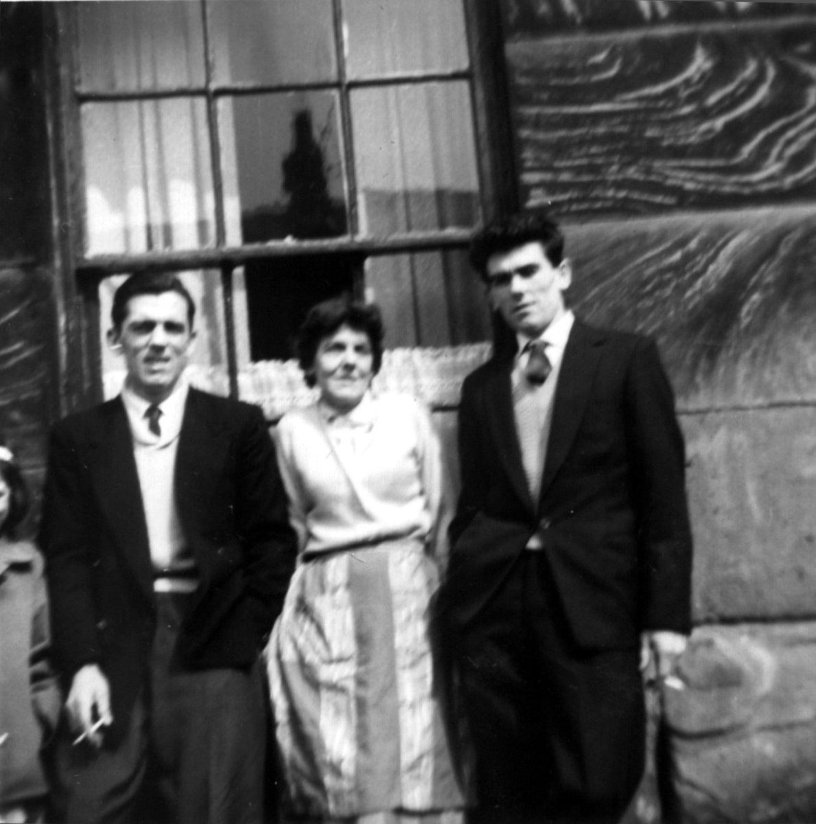 My mum Jeanie and with her two of her brothers Billy and Tommy standing outside nana's house