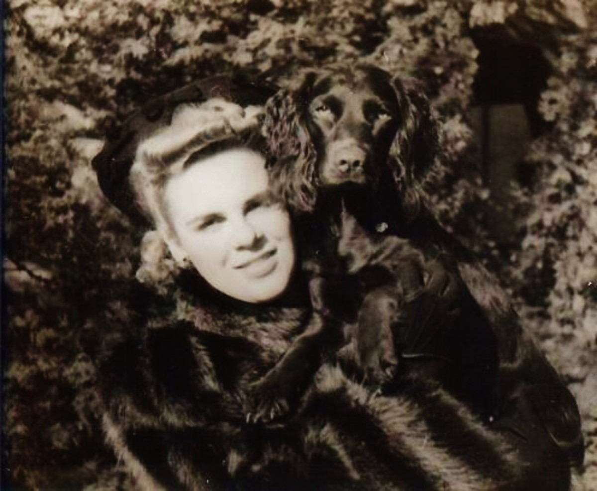 My mother with her muskrat fur coat and dog Tuffy draped over her shoulder.