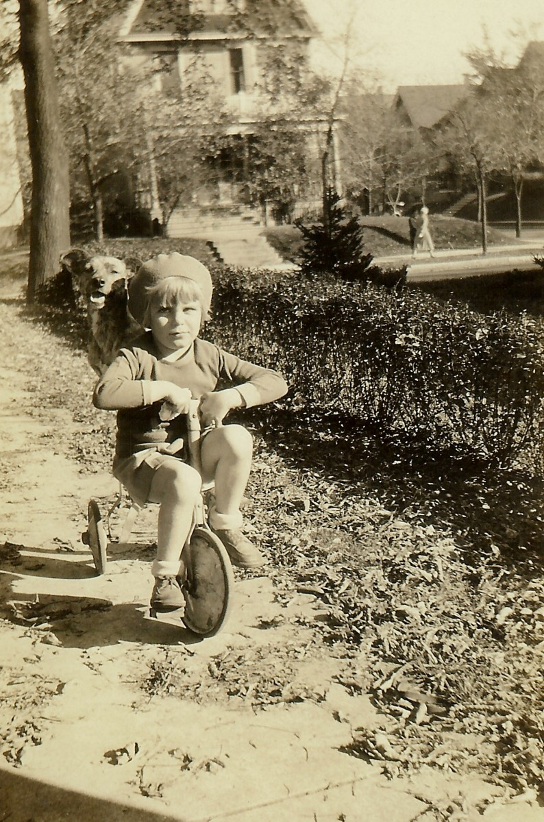 Here she is riding with dog Jiggs on the back of her tricycle.