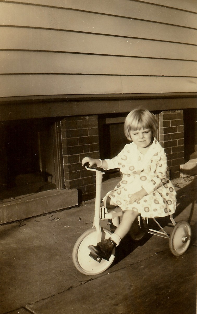 My mother riding a tricycle
