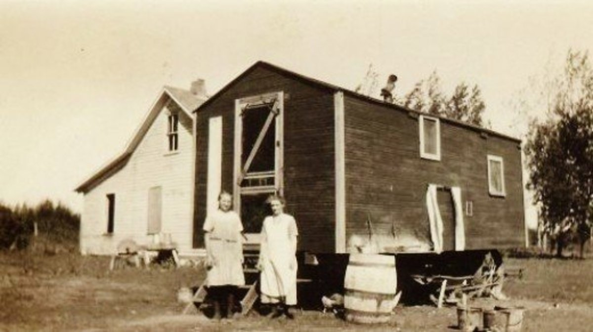 "The women would prepare meals and the food would be transported to the men in the field during threshing time. This building called a ""cook house"" was on wheels and the horses would pull it."