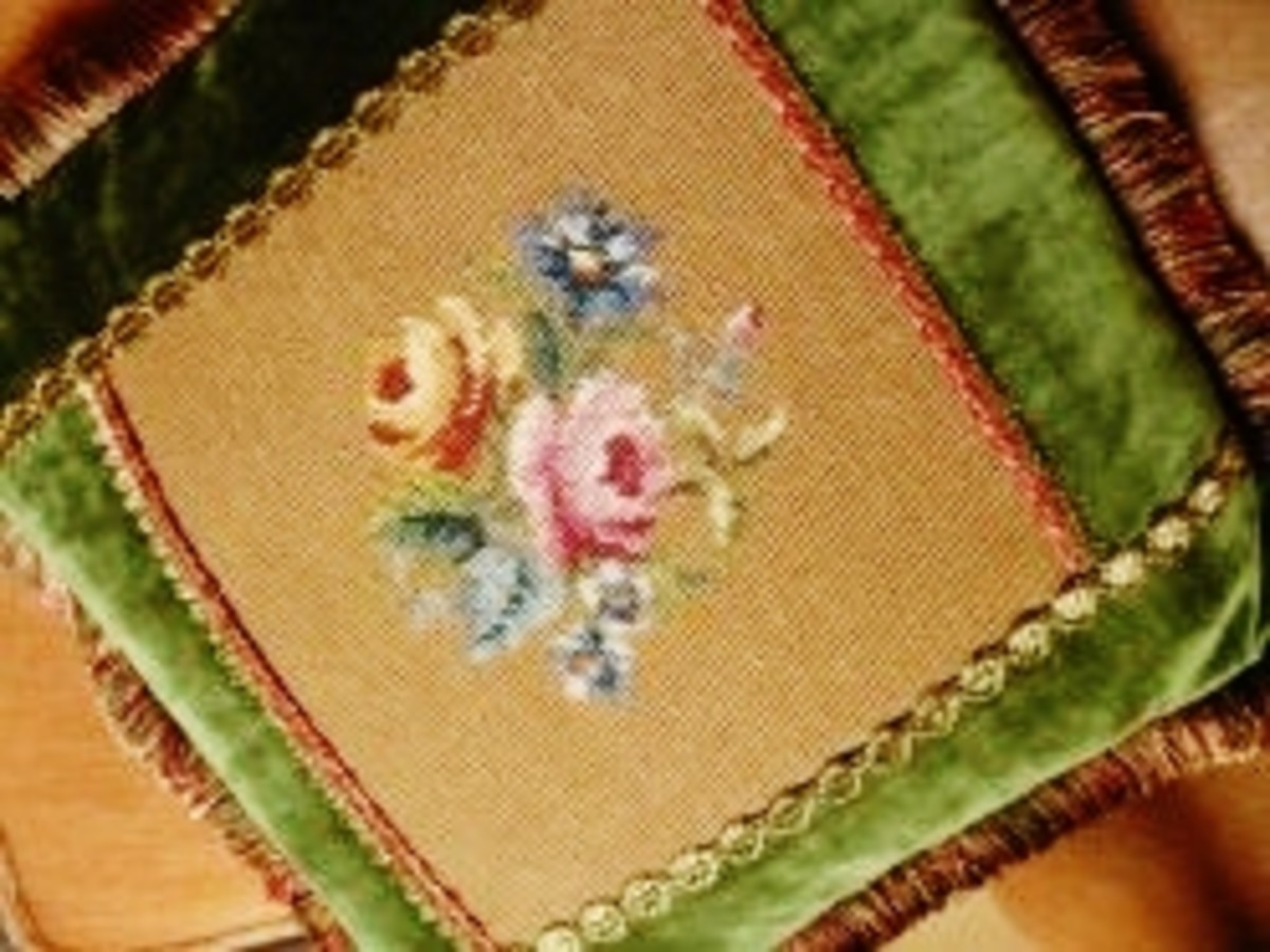 The center of this pillow is needlepoint created by my grandmother.