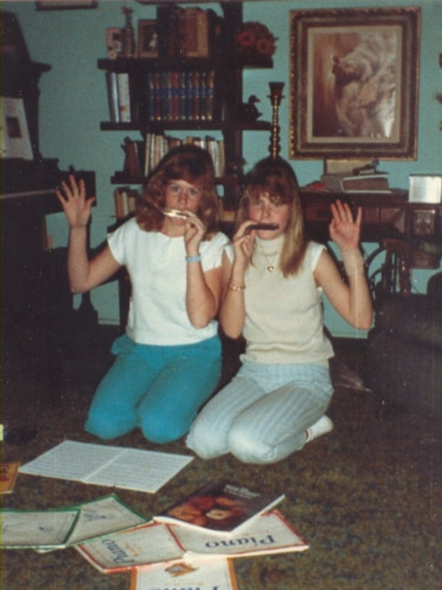 This is Sarah with her friend Heather.  Evidently they are enjoying making music together at Heather's home. Heather's mother was also Sarah's teacher at this time.
