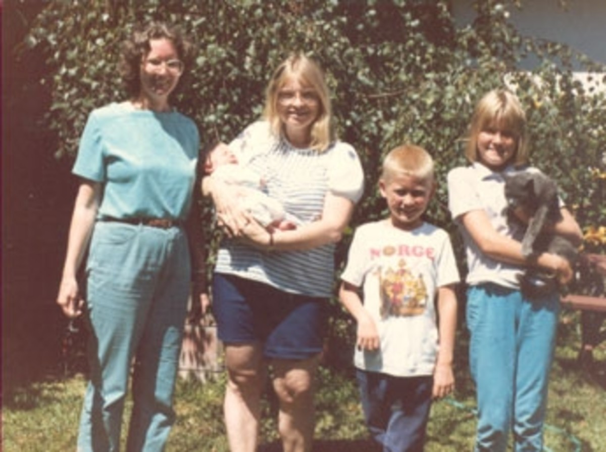 On this day we had introduced our children to our friends Helen and Bruce. Helen has a new baby. Sarah is holding a cat, as usual, if there is one around to hold. I am on the left side.