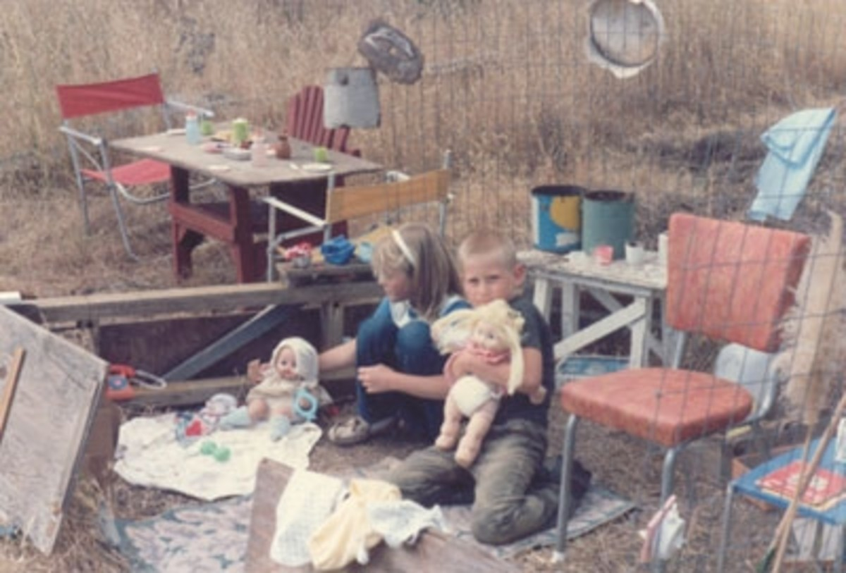This picture was taken in Carmel Valley at the home of Kosta's parents. You can see the creativity of both children as they have made themselves a house to play in, using whatever materials they could find.