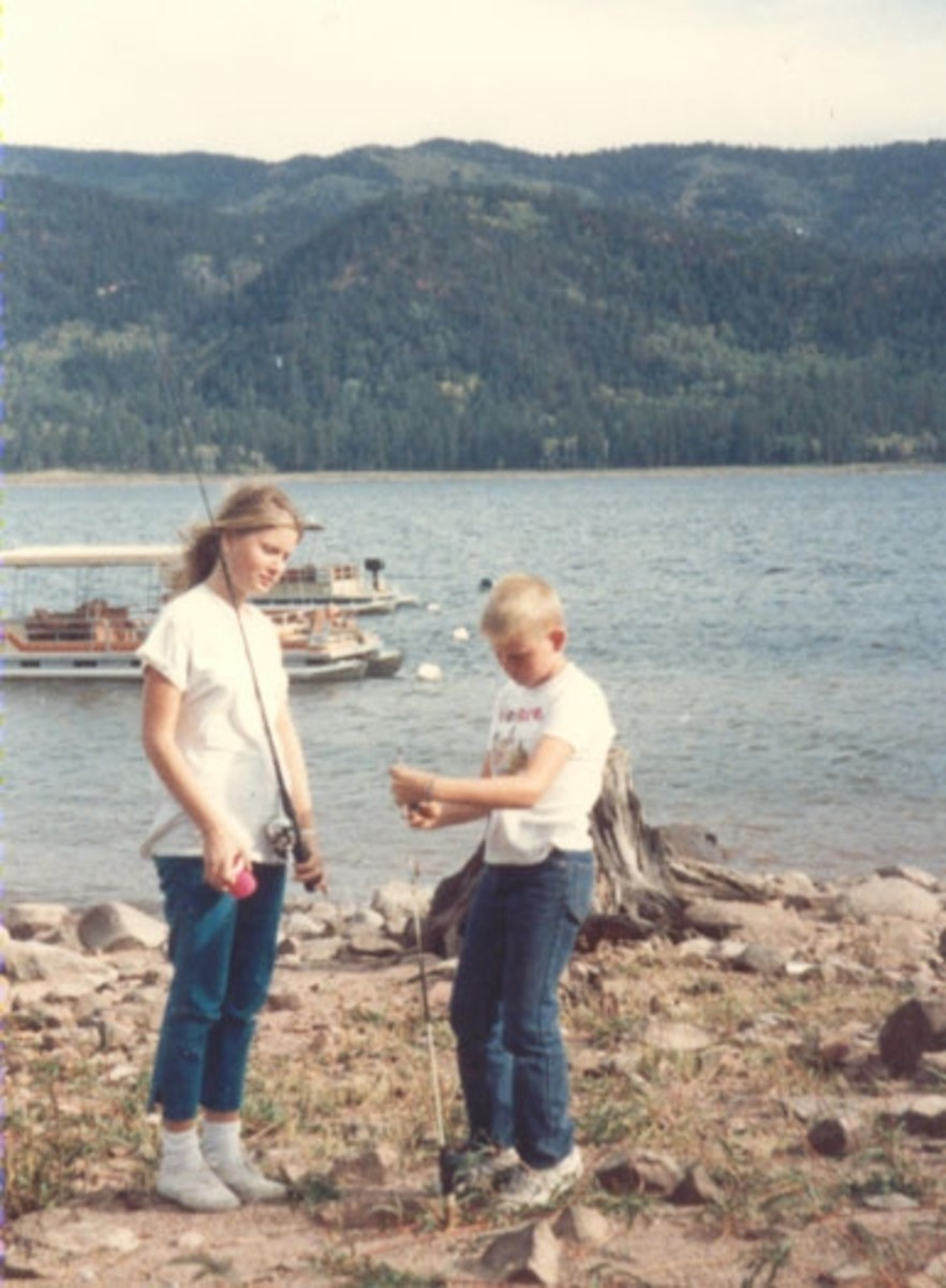 The next day, the children learned to fish on the shore of the lake. The neighbor in the next cabin showed them how.
