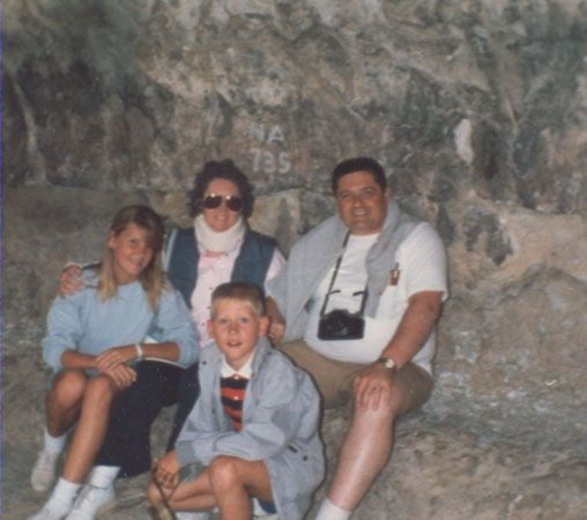 This is our family taking a rest during our exploration of the cliff dwellings at Mesa Verde.