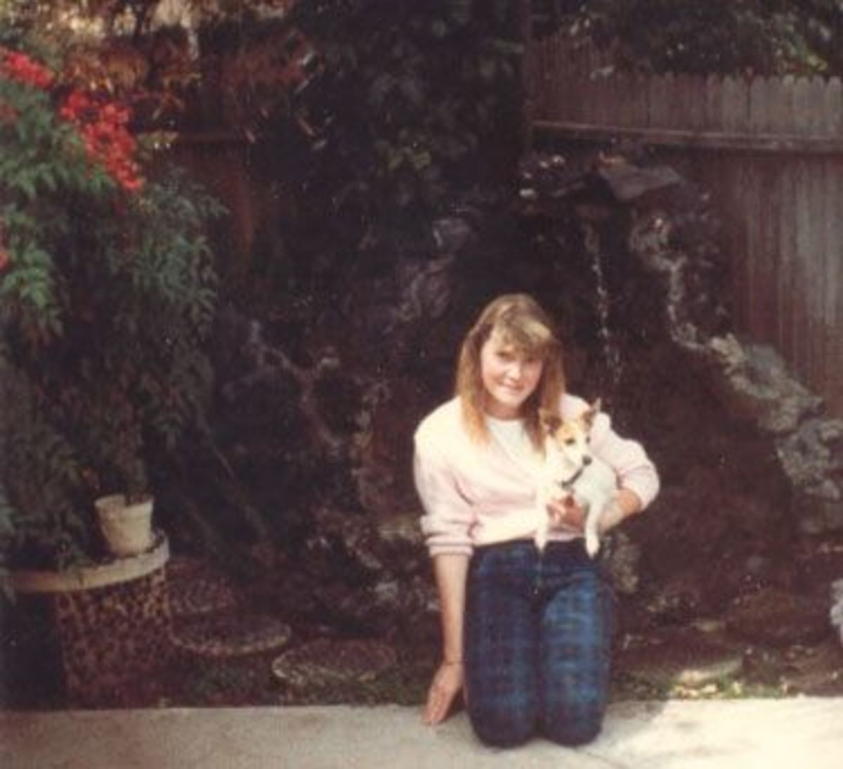 I'm not sure where this was taken, probably next door. Once again, Sarah is holding an animal.