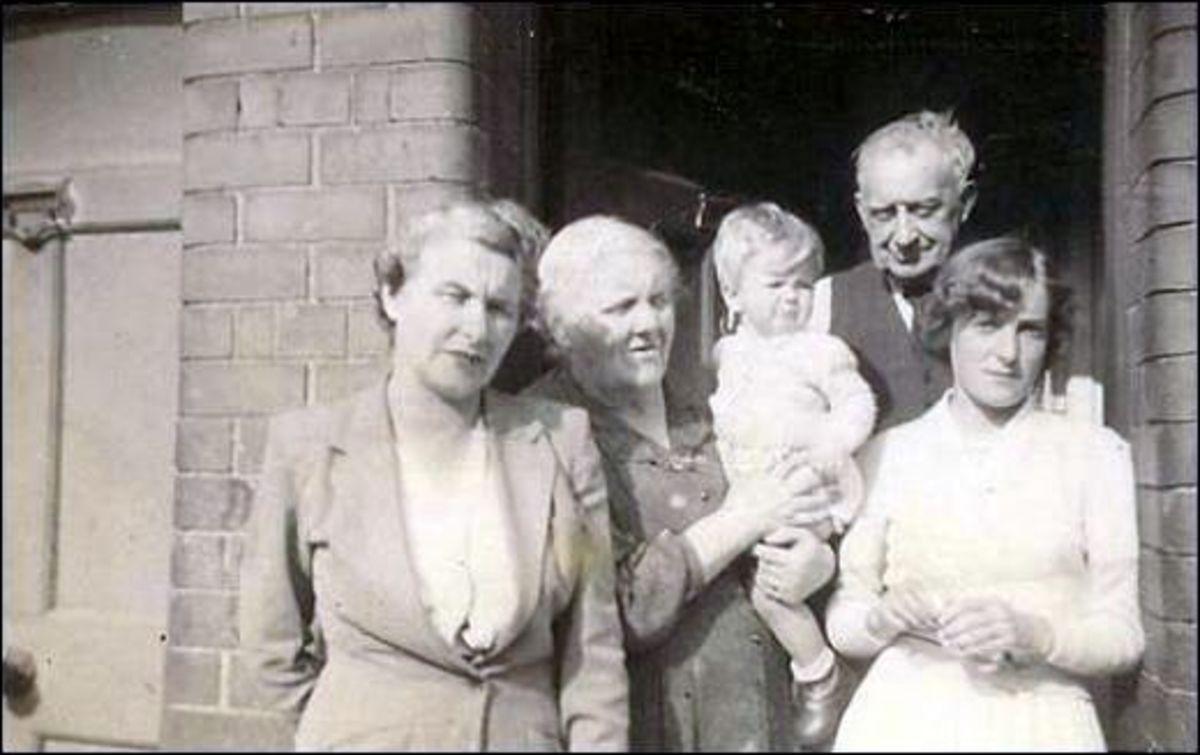 Harold Road, Stoneybatter Dublin 7 Ireland. 1955 . Bridget Maguire, Dora Maguire, Dora's great grandson Leo Reid, Paddy Maguire and Deirdre Maguire.