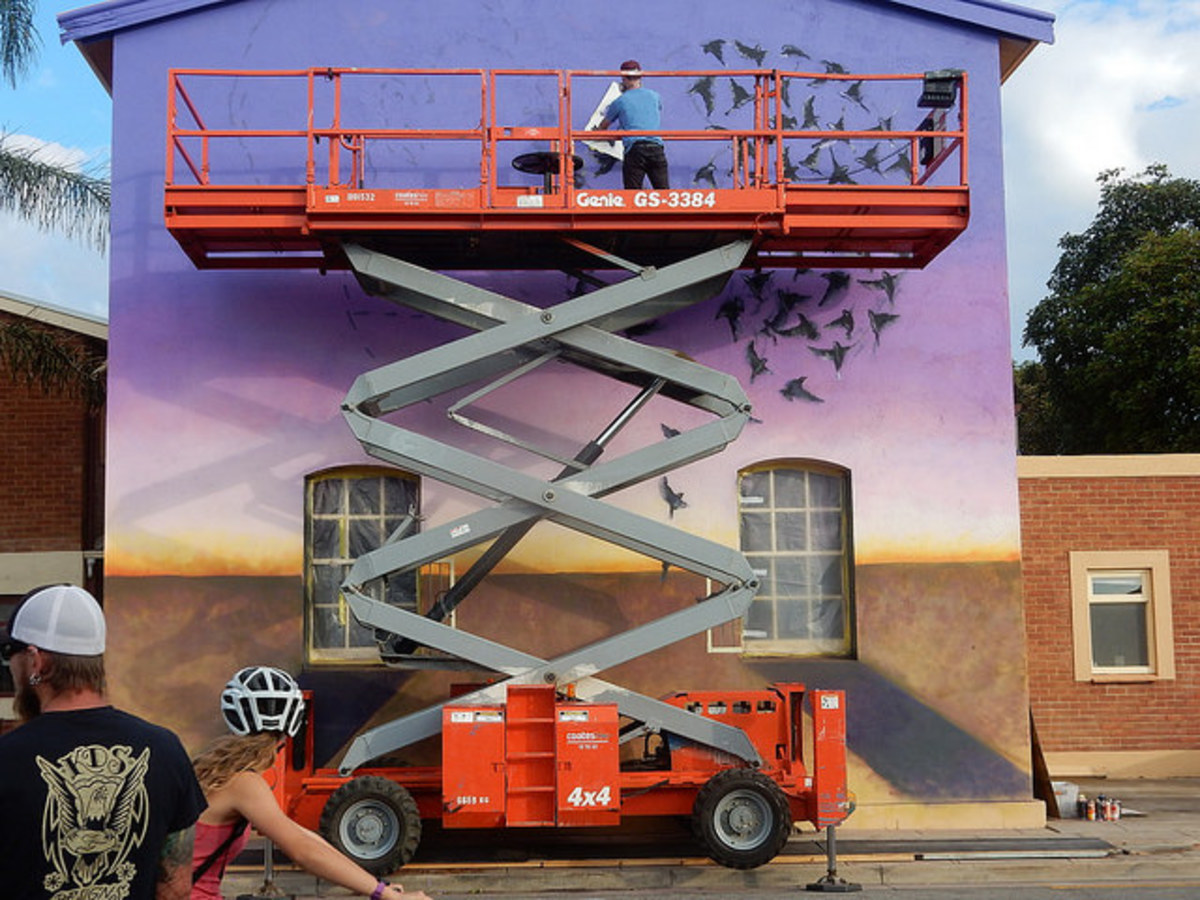 A scissor lift is one way to work safely at heights above the ground that might be shaky on a ladder