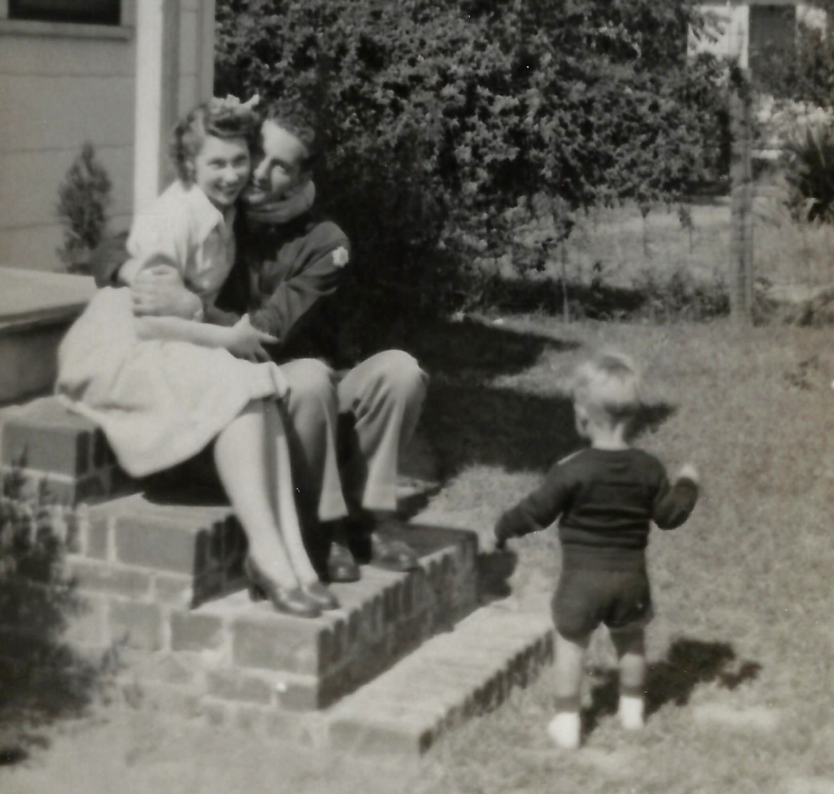 The happy day arrived!  Father, mother and son reunited after the war!