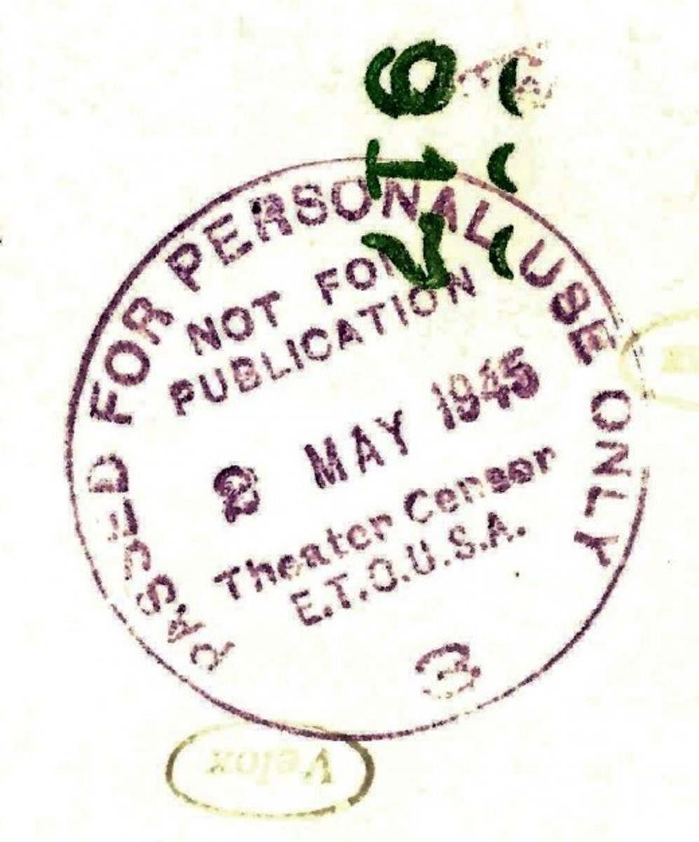 Censor mark on the back of pictures sent home from war zones.